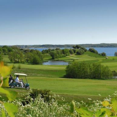 Play a game of golf with a scenic view of inlet Flensborg Fjord in the Sønderborg-area