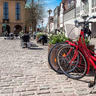 Red bikes in front of the city hall in Sønderborg